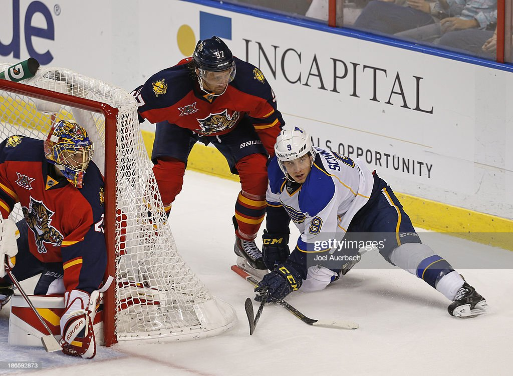 <a gi-track='captionPersonalityLinkClicked' href=/galleries/search?phrase=Jaden+Schwartz&family=editorial&specificpeople=7029354 ng-click='$event.stopPropagation()'>Jaden Schwartz</a> #9 of the St. Louis Blues is taken to the ice by <a gi-track='captionPersonalityLinkClicked' href=/galleries/search?phrase=Matt+Gilroy&family=editorial&specificpeople=817917 ng-click='$event.stopPropagation()'>Matt Gilroy</a> #97 of the Florida Panthers at the BB&T Center on November 1, 2013 in Sunrise, Florida. The Blues defeated the Panthers 4-0.