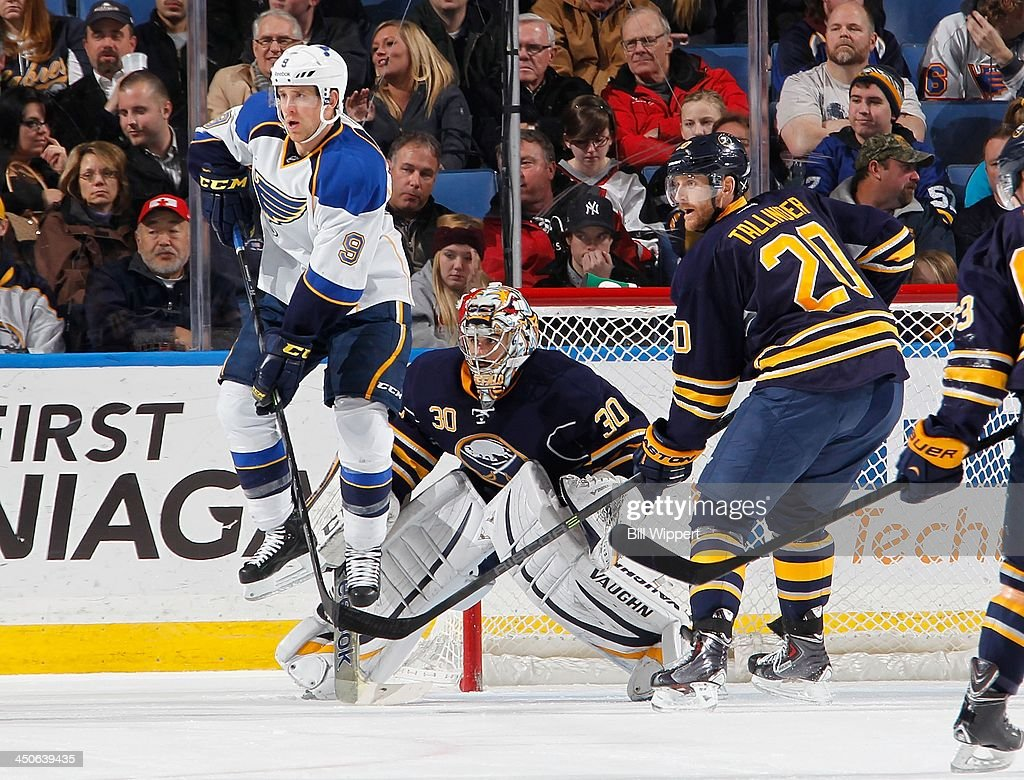 <a gi-track='captionPersonalityLinkClicked' href=/galleries/search?phrase=Jaden+Schwartz&family=editorial&specificpeople=7029354 ng-click='$event.stopPropagation()'>Jaden Schwartz</a> #9 of the St. Louis Blues jumps in the air to screen Ryan Miller #30 of the Buffalo Sabres with <a gi-track='captionPersonalityLinkClicked' href=/galleries/search?phrase=Henrik+Tallinder&family=editorial&specificpeople=204661 ng-click='$event.stopPropagation()'>Henrik Tallinder</a> #20 alongside on November 19, 2013 at the First Niagara Center in Buffalo, New York. St. Louis won, 4-1.