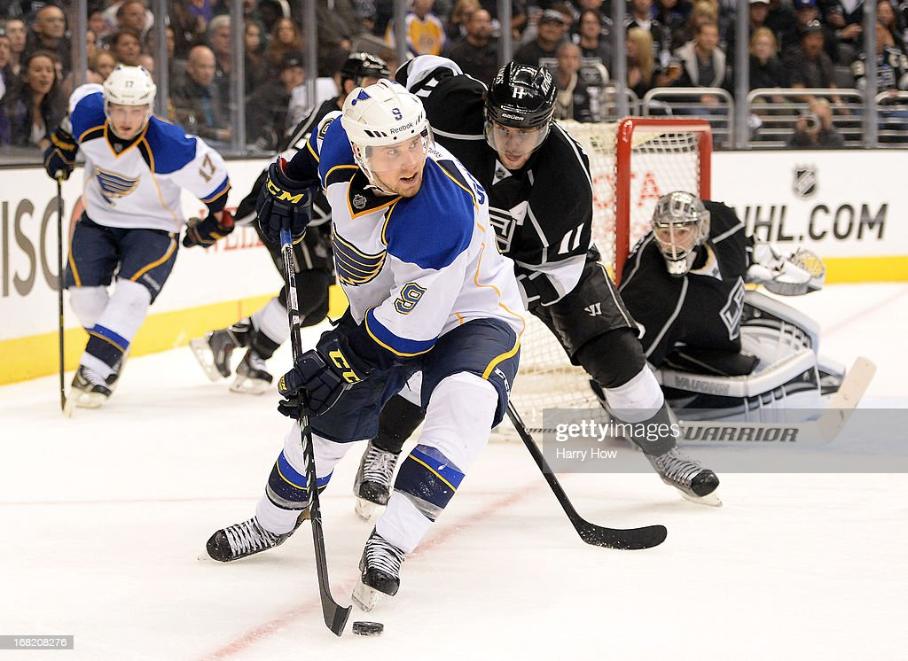 <a gi-track='captionPersonalityLinkClicked' href=/galleries/search?phrase=Jaden+Schwartz&family=editorial&specificpeople=7029354 ng-click='$event.stopPropagation()'>Jaden Schwartz</a> #9 of the St. Louis Blues looks to make a play as he is watched by <a gi-track='captionPersonalityLinkClicked' href=/galleries/search?phrase=Anze+Kopitar&family=editorial&specificpeople=634911 ng-click='$event.stopPropagation()'>Anze Kopitar</a> #11 of the Los Angeles Kings during the third period of a 4-3 Kings win in Game Four of the Western Conference Quarterfinals during the 2013 NHL Stanley Cup Playoffs at Staples Center on May 6, 2013 in Los Angeles, California.