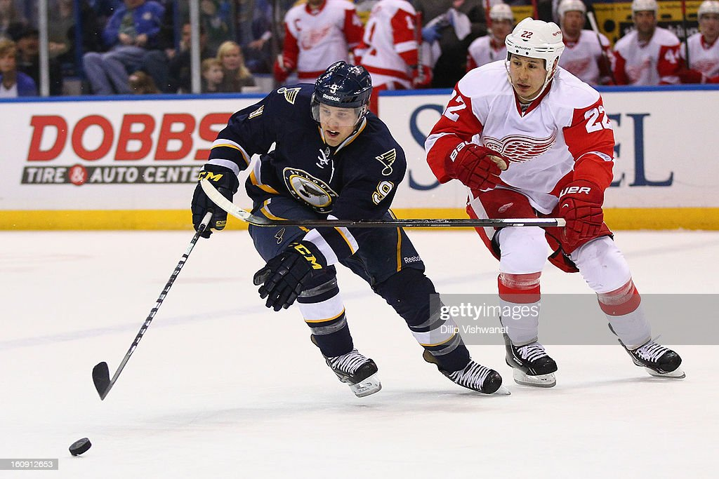 Jaden Schwartz #9 of the St. Louis Blues loses control of the puck against Daniel Cleary #11 of the Detroit Red Wings at the Scottrade Center on February 7, 2013 in St. Louis, Missouri.