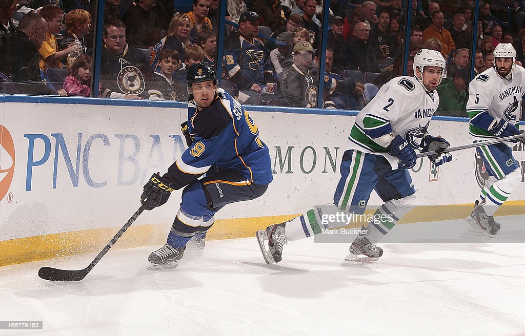 <a gi-track='captionPersonalityLinkClicked' href=/galleries/search?phrase=Jaden+Schwartz&family=editorial&specificpeople=7029354 ng-click='$event.stopPropagation()'>Jaden Schwartz</a> #9 of the St. Louis Blues skates against <a gi-track='captionPersonalityLinkClicked' href=/galleries/search?phrase=Dan+Hamhuis&family=editorial&specificpeople=204213 ng-click='$event.stopPropagation()'>Dan Hamhuis</a> #2 of the Vancouver Canucks in an NHL game on April 16, 2013 at Scottrade Center in St. Louis, Missouri.