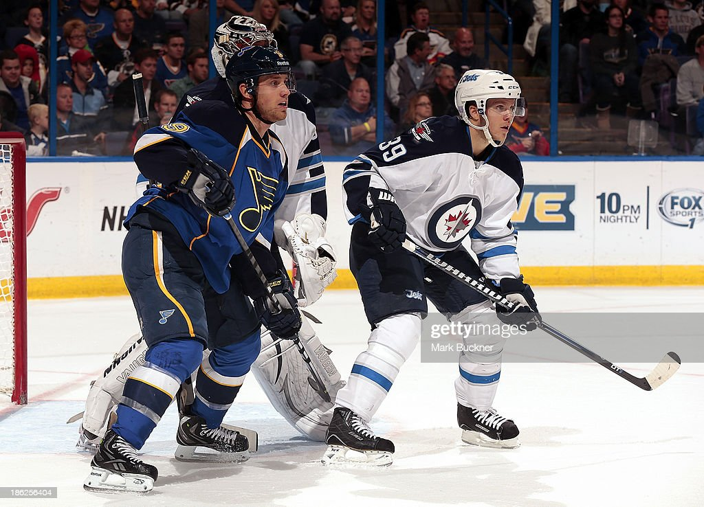 <a gi-track='captionPersonalityLinkClicked' href=/galleries/search?phrase=Jaden+Schwartz&family=editorial&specificpeople=7029354 ng-click='$event.stopPropagation()'>Jaden Schwartz</a> #9 of the St. Louis Blues skates against <a gi-track='captionPersonalityLinkClicked' href=/galleries/search?phrase=Tobias+Enstrom&family=editorial&specificpeople=2538468 ng-click='$event.stopPropagation()'>Tobias Enstrom</a> #39 of the Winnipeg Jets on October 29, 2013 at Scottrade Center in St. Louis, Missouri.