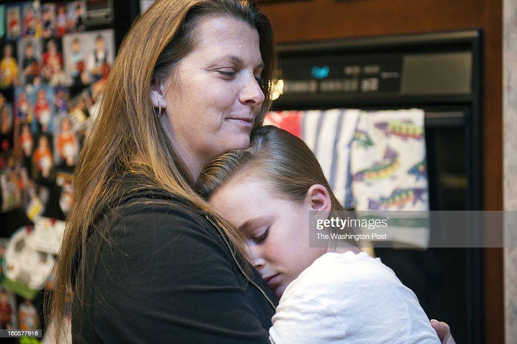 Jaden Steele, 11, gives her mom, Denise Steele, an impromtu hug Thursday, January 31, 2013 in Sterling, VA.
