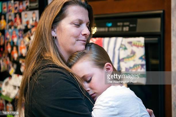 Jaden Steele gives her mom Denise Steele an impromtu hug Thursday January 31 2013 in Sterling VA