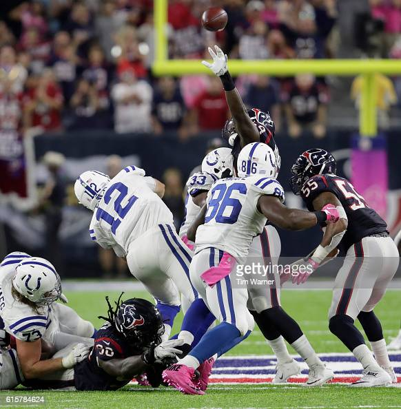 Jadeveon Clowney of the Houston Texans and Whitney Merciless pressure Andrew Luck of the Indianapolis Colts in the fourth quarter during the NFL game...