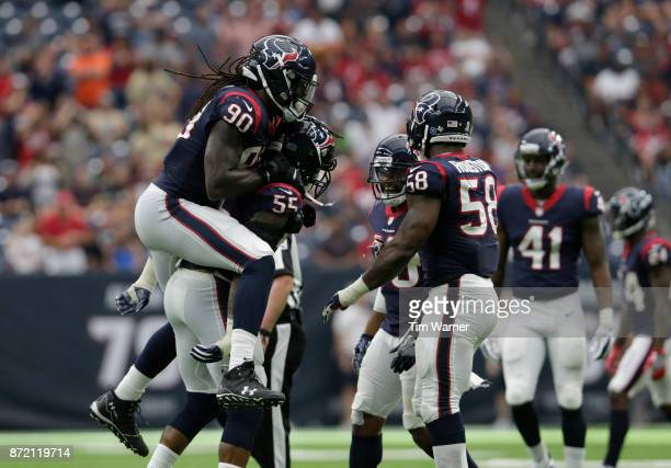 Jadeveon Clowney of the Houston Texans celebrates with Benardrick McKinney after a second half sack against the Indianapolis Colts at NRG Stadium on...