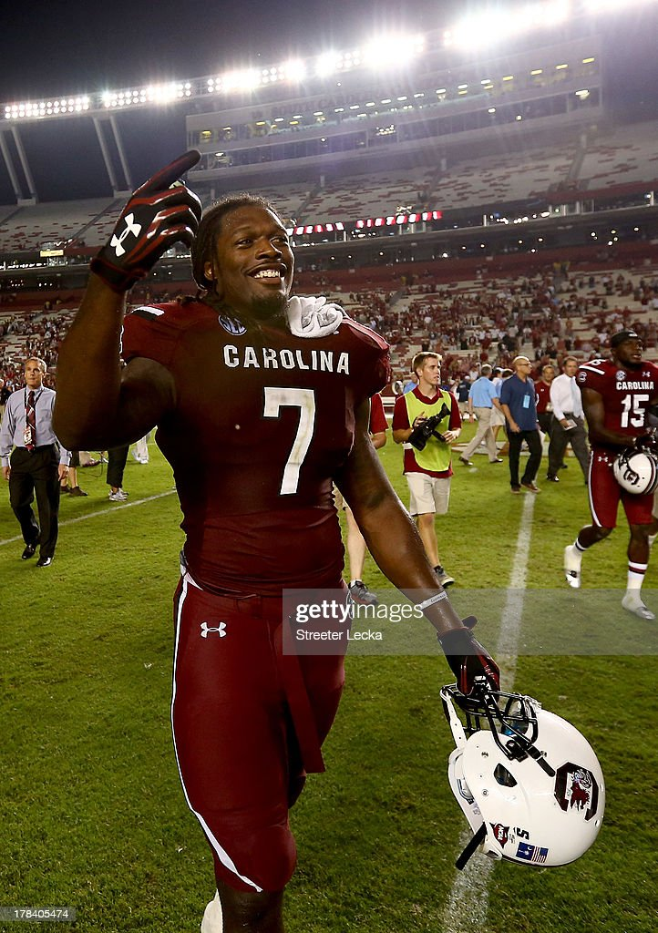 Jadeveon Clowney #7 of the South Carolina Gamecocks celebrates after defeating the North Carolina Tar Heels 27-10 at Williams-Brice Stadium on August 29, 2013 in Columbia, South Carolina.