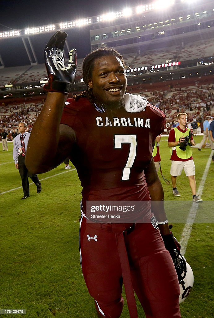 <a gi-track='captionPersonalityLinkClicked' href=/galleries/search?phrase=Jadeveon+Clowney&family=editorial&specificpeople=7471550 ng-click='$event.stopPropagation()'>Jadeveon Clowney</a> #7 of the South Carolina Gamecocks celebrates after defeating the North Carolina Tar Heels 27-10 at Williams-Brice Stadium on August 29, 2013 in Columbia, South Carolina.