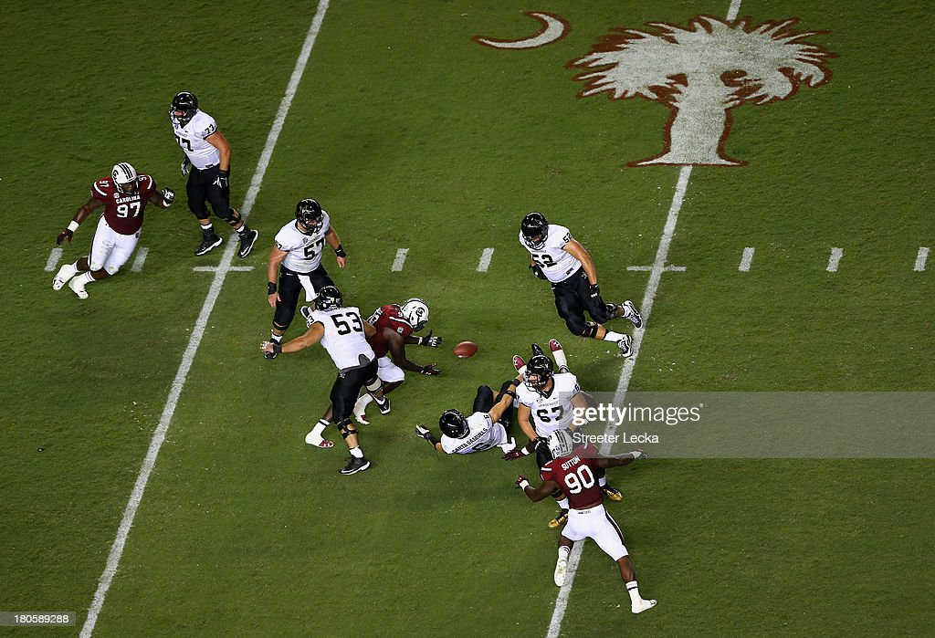 <a gi-track='captionPersonalityLinkClicked' href=/galleries/search?phrase=Jadeveon+Clowney&family=editorial&specificpeople=7471550 ng-click='$event.stopPropagation()'>Jadeveon Clowney</a> #7 of the South Carolina Gamecocks sacks Austyn Carta-Samuels #6 of the Vanderbilt Commodores during their game at Williams-Brice Stadium on September 14, 2013 in Columbia, South Carolina.