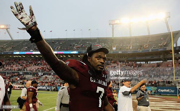 Jadeveon Clowney of the South Carolina Gamecocks walks off the field after the Gamecocks defeated the Wisconsin Badgers 3424 at the Capital One Bowl...