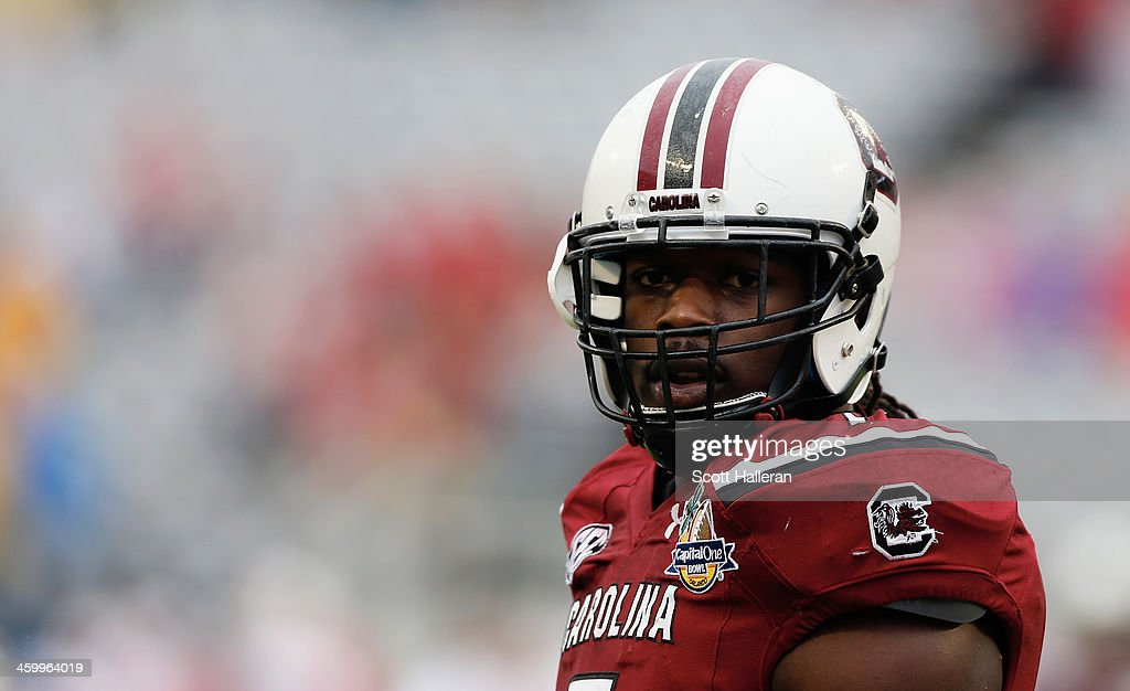 <a gi-track='captionPersonalityLinkClicked' href=/galleries/search?phrase=Jadeveon+Clowney&family=editorial&specificpeople=7471550 ng-click='$event.stopPropagation()'>Jadeveon Clowney</a> #7 of the South Carolina Gamecocks works out on the field before the start of their game against the Wisconsin Badgers at the Capital One Bowl on January 1, 2014 in Orlando, Florida.