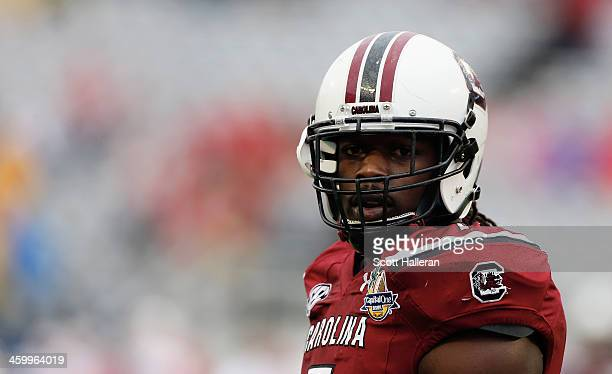 Jadeveon Clowney of the South Carolina Gamecocks works out on the field before the start of their game against the Wisconsin Badgers at the Capital...