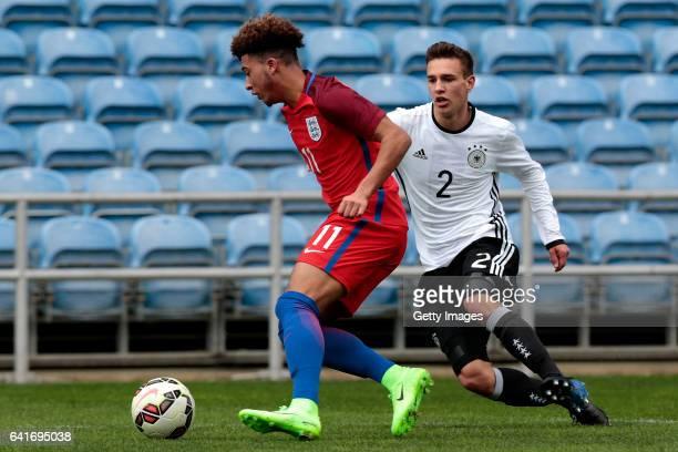 Jadon Malik Sancho of England U17 challenges Alexander Nitzl of Germany U17 during the U17 Algarve Cup Tournament Match between England U17 and...