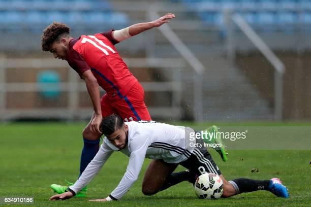 Jadon Malik Sancho of England U17 challenges Sahverdi Cetin of Germany U17 during the U17 Algarve Cup Tournament Match between England U17 and...