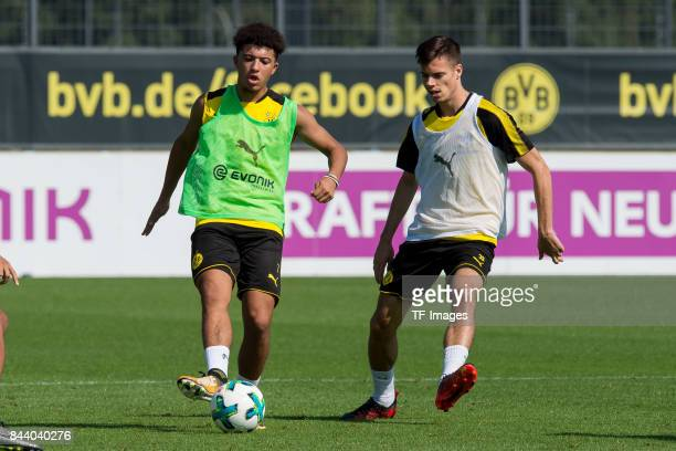 Jadon Sancho of Dortmund and Julian Weigl of Dortmund battle for the ball during a training session at the BVB Training center on September 4 2017 in...