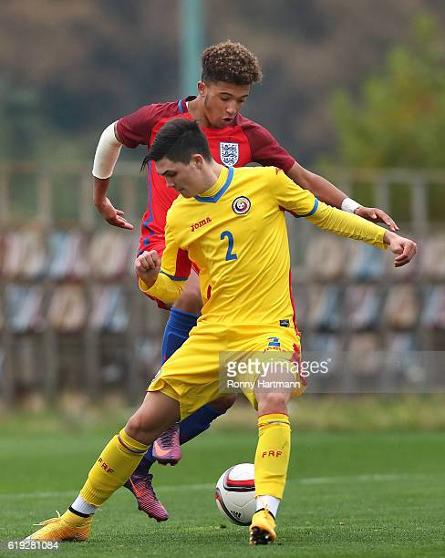 Jadon Sancho of England and Alexandru Sabangeanu of Romania vie during the UEFA Under17 EURO Qualifier between U17 England and U17 Romania at...