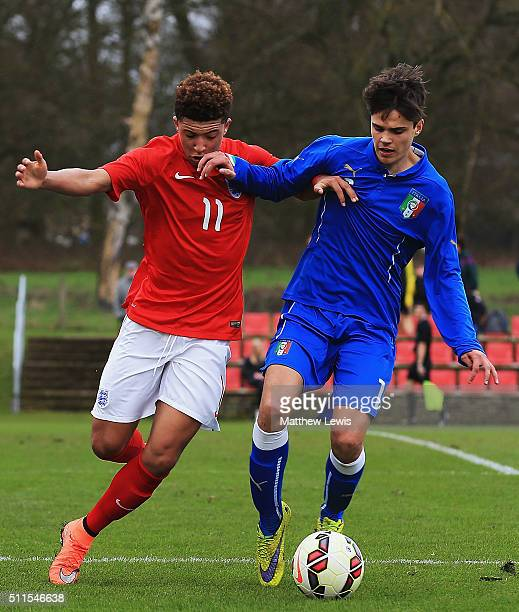 Jadon Sancho of England and Lorenzo Gavioli of Italy challenege for the ball during the U16s International Friendly match between England U16 and...