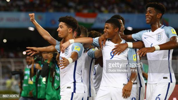 Jadon Sancho of England celebrate with his teammates after scoring a goal during the FIFA U17 World Cup India 2017 group F match between England and...