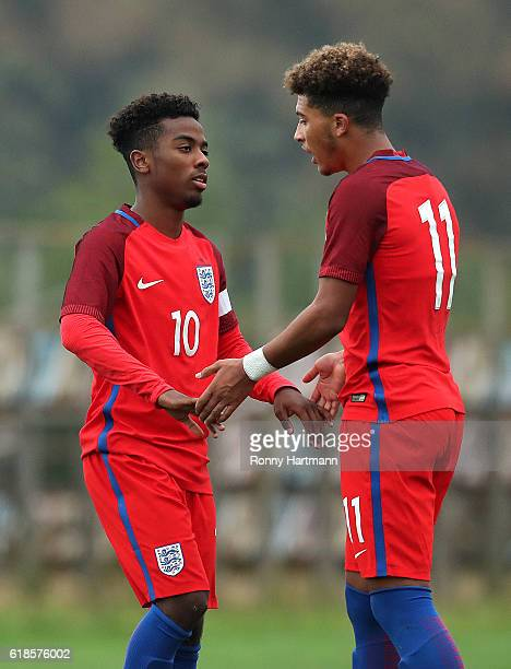 Jadon Sancho of England celebrates after scoring his team's third goal with Angel Gomes of England during the UEFA Under17 EURO Qualifier between U17...
