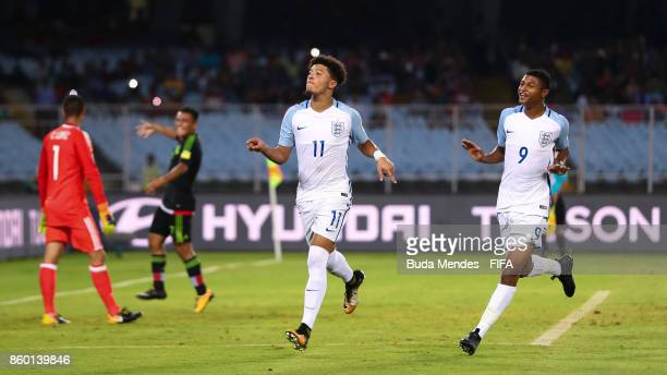 Jadon Sancho of England celebrates with Rhian Brewster after scoring a goal during the FIFA U17 World Cup India 2017 group F match between England...