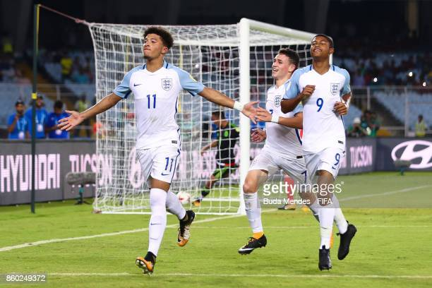 Jadon Sancho Rhian Brewster and Philip Foden of England celebrate a scored goal during the FIFA U17 World Cup India 2017 group F match between...