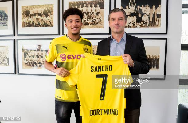 Jadon Sancho signs a new contract with Borussia Dortmund with Michael Zorc on August 31 2017 in Dortmund Germany