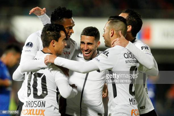 Jadson of Brazil's Corinthians celebrates with teammates after scoring against Chile's Universidad de Chile during their Copa Sudamericana football...