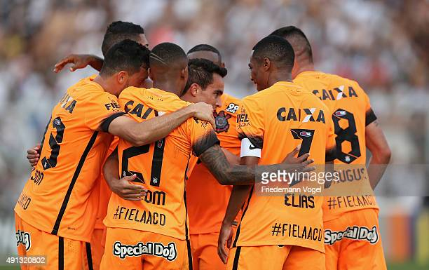 Jadson of Corinthians celebrates scoring the first goal with his team during the match between Ponte Preta and Corinthians for the Brazilian Series A...
