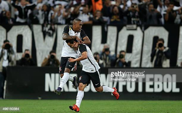 Jadson of Corinthians celebrates scoring the first goal with Malcom during the match between Corinthians and Coritiba for the Brazilian Series A 2015...