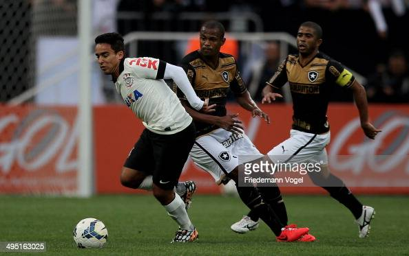 Jadson of Corinthians fights for the ball with Airton and Junior Cesar of Botafogo during the match between Corinthians and Botafogo for the...