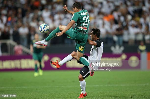 Jadson of Corinthians fights for the ball with Juninho of Coritiba during the match between Corinthians and Coritiba for the Brazilian Series A 2015...