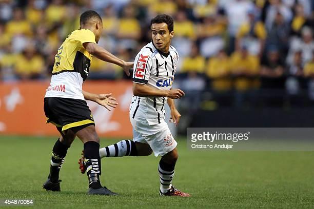 Jadson of Corinthians in action during a match between Criciuma and Corinthians as part of Campeonato Brasileiro 2014 at Heriberto Hulse Stadium on...