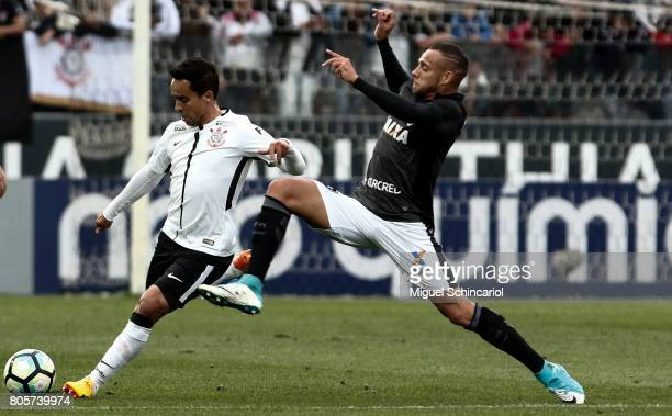 Jadson of Corinthians vies for the ball with of Botafogo during the match between Corinthians and Botafogo for the Brasileirao Series A 2017 at Arena...