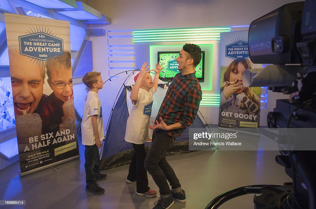Jadyn Schill, 10, and her brother Austin, 8, have fun with YTV 'The Zone' host Carlos Bustamante (R) after taping a promotion for a SickKids sponsored summer camp at Corus Quay studios, March 29, 2013. Jadyn was diagnosed with a rare brain tumour in 2008. She has undergone three brain surgeries to remove her previous tumours, many chemotherapy sessions and 93 rounds of radiation. She is the most radiated child in Canada. Despite this gruelling odyssey, Jadyn is a cheerful, outgoing and feisty little girl.