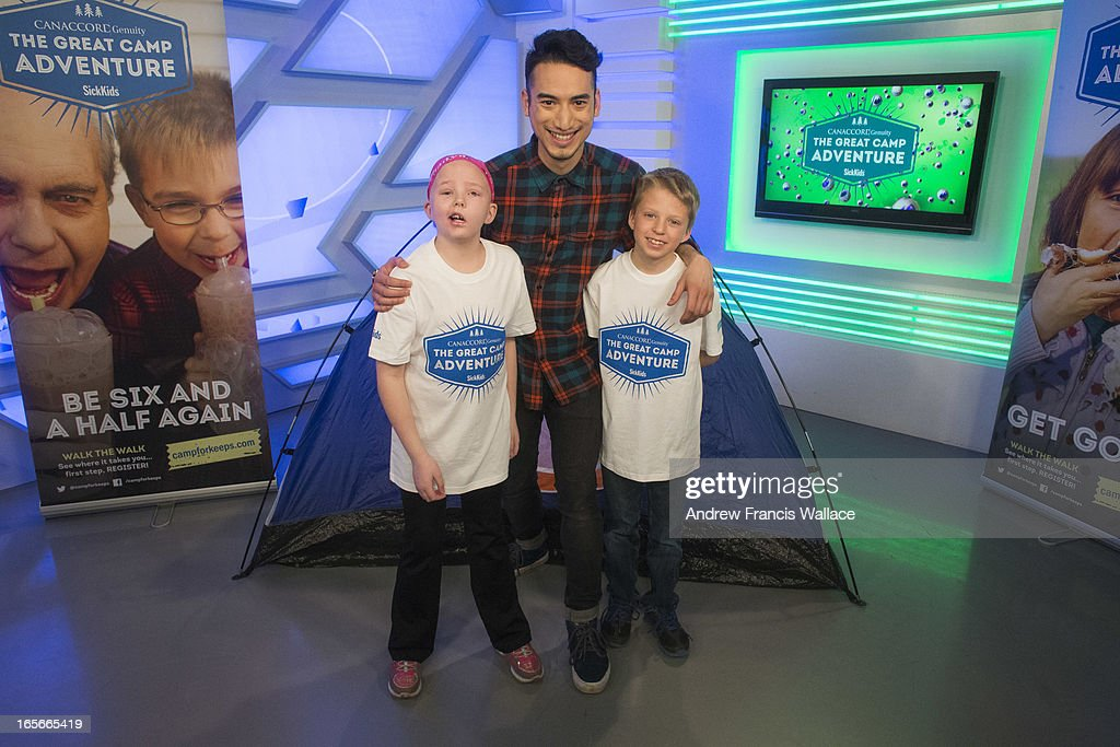 Jadyn Schill, 10, and her brother Austin, 8, pose with YTV 'The Zone' host Carlos Bustamante (R) after taping a promotion for a SickKids sponsored summer camp at Corus Quay studios, March 29, 2013. Jadyn was diagnosed with a rare brain tumour in 2008. She has undergone three brain surgeries to remove her previous tumours, many chemotherapy sessions and 93 rounds of radiation. She is the most radiated child in Canada. Despite this gruelling odyssey, Jadyn is a cheerful, outgoing and feisty little girl.