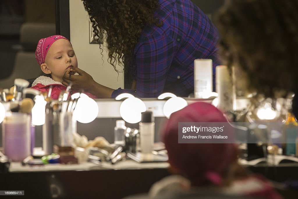 Jadyn Schill, 10, gets make-up from Joanne Parks in preparation for taping of a promotion for a SickKids sponsored summer camp at Corus Quay studios, March 29, 2013. Jadyn was diagnosed with a rare brain tumour in 2008. She has undergone three brain surgeries to remove her previous tumours, many chemotherapy sessions and 93 rounds of radiation. She is the most radiated child in Canada. Despite this gruelling odyssey, Jadyn is a cheerful, outgoing and feisty little girl.