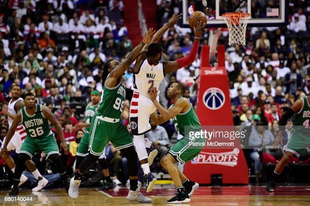 Jae Crowder and Avery Bradley of the Boston Celtics defend against John Wall of the Washington Wizards in the second half in Game Four of the Eastern...