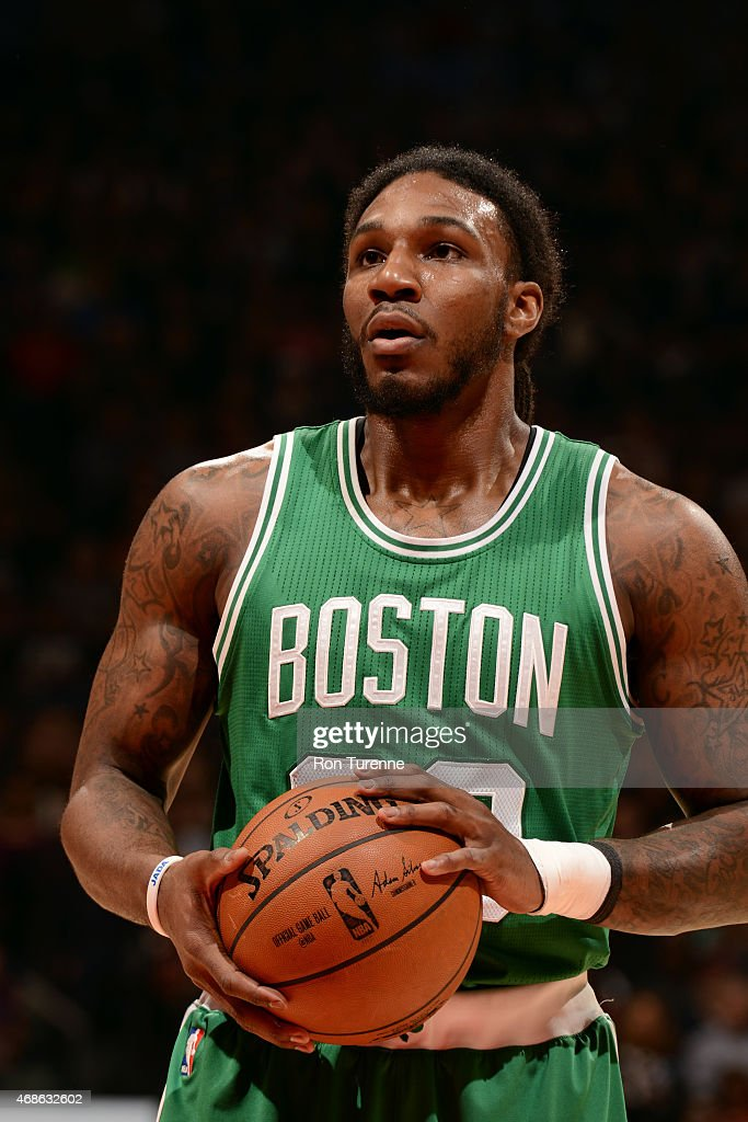 Jae Crowder of the Boston Celtics attempts a free throw against the Toronto Raptors on April 4 2015 at the Air Canada Centre in Toronto Ontario...