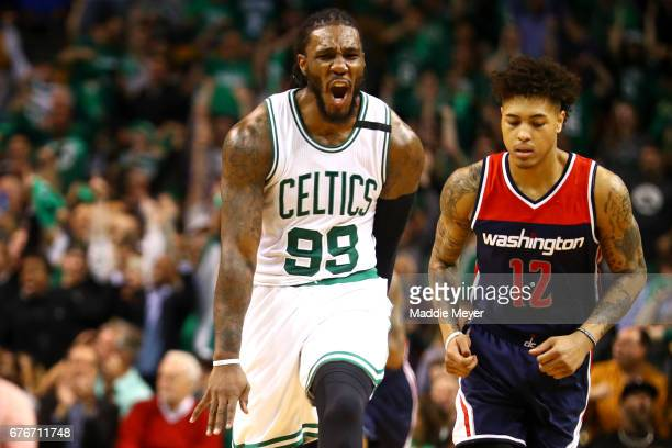 Jae Crowder of the Boston Celtics celebrates next to Kelly Oubre Jr #12 of the Washington Wizards during the second quarter of Game Two of the...