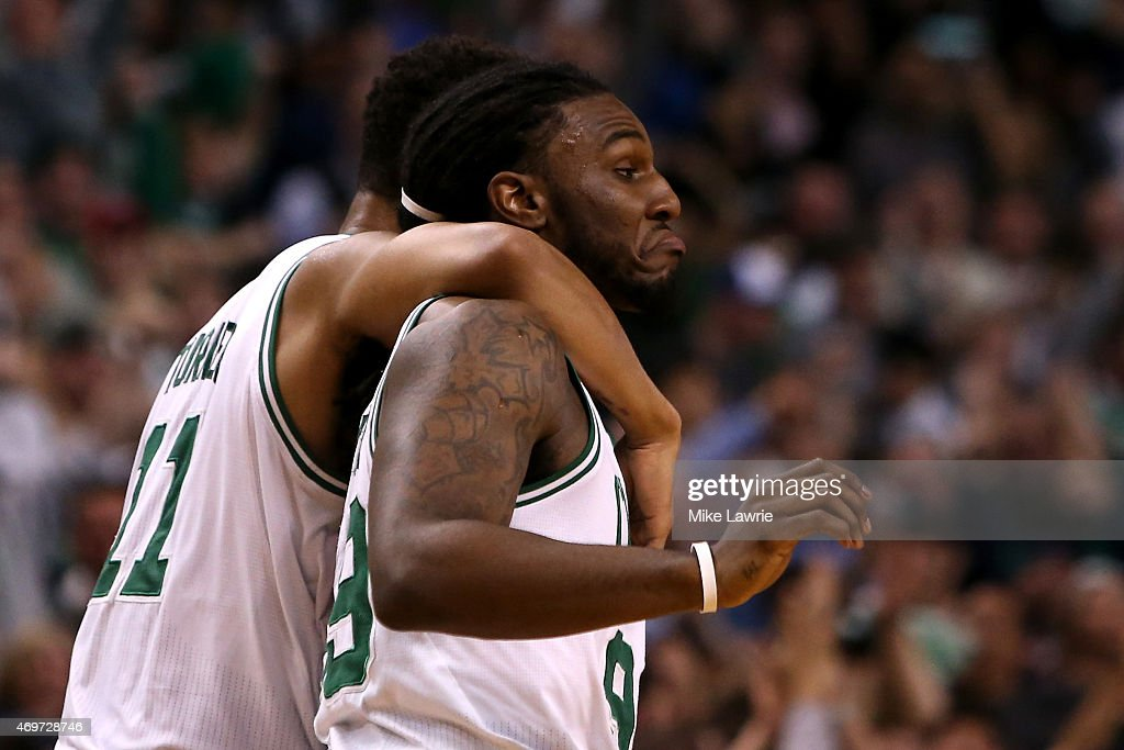 Jae Crowder of the Boston Celtics celebrates with Evan Turner after making a go ahead basket late in the fourth quarter against the Toronto Raptors...