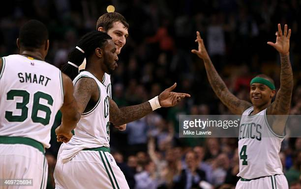 Jae Crowder of the Boston Celtics celebrates with teammates after making a basket late in the fourth quarter against the Toronto Raptors at TD Garden...