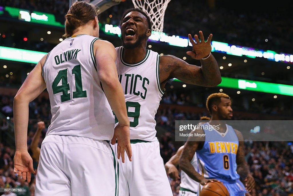 Jae Crowder of the Boston Celtics congratulates Kelly Olynyk after he scored against the Denver Nuggets during the third quarter at TD Garden on...