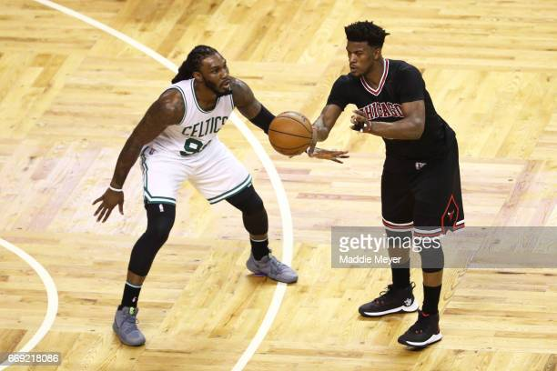 Jae Crowder of the Boston Celtics defends Jimmy Butler of the Chicago Bulls during the third quarter of Game One of the Eastern Conference...