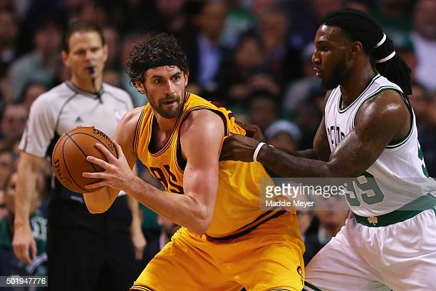 Jae Crowder of the Boston Celtics defends Kevin Love of the Cleveland Cavaliers during the third quarter at TD Garden on December 15 2015 in Boston...