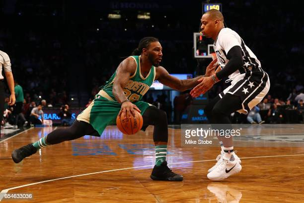 Jae Crowder of the Boston Celtics drives to teh basket against Randy Foye of the Brooklyn Nets at Barclays Center on March 17 2017 in New York City...