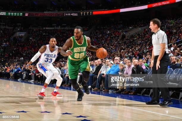 Jae Crowder of the Boston Celtics drives to the basket against the Philadelphia 76ers at Wells Fargo Center on March 19 2017 in Philadelphia...