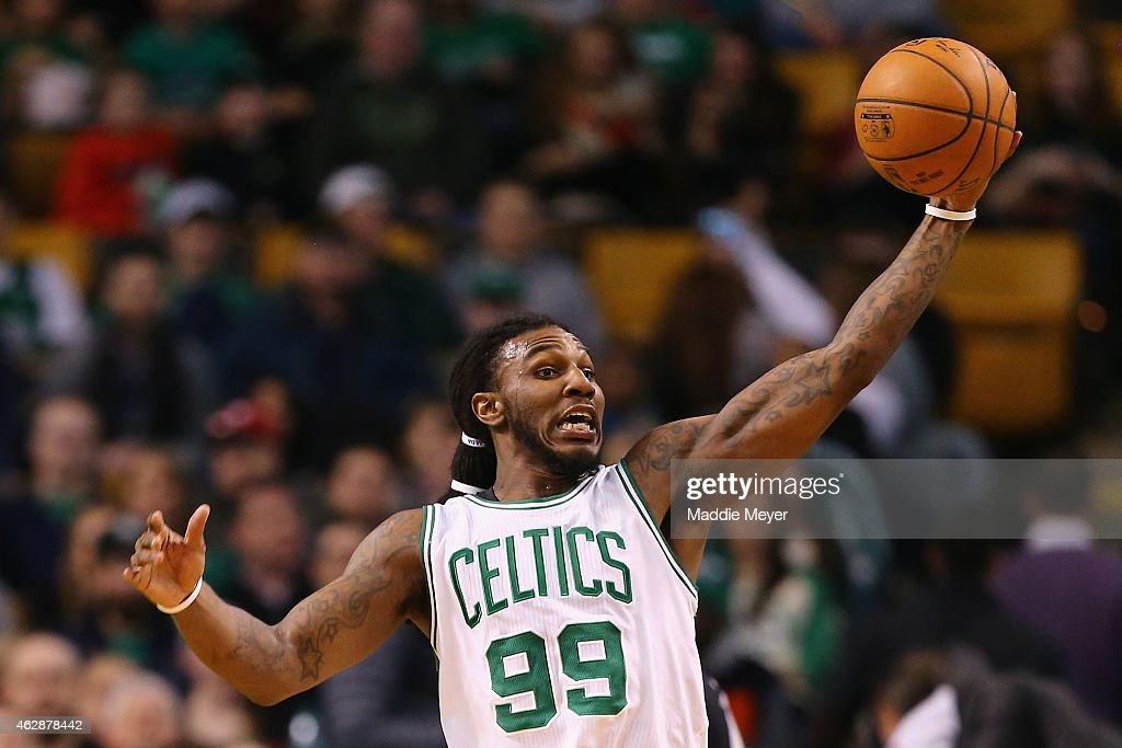 Jae Crowder of the Boston Celtics grabs a rebound during the 3rd quarter against the Philadelphia 76ers at TD Garden on February 6 2015 in Boston...