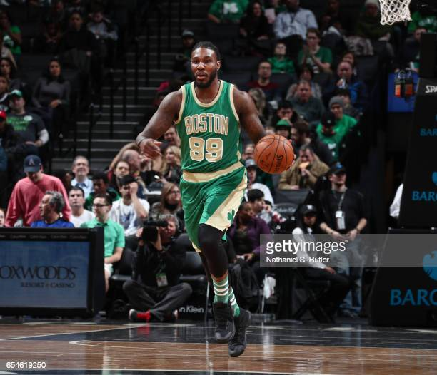 Jae Crowder of the Boston Celtics handles the ball during a game against the Brooklyn Nets on March 17 2017 at Barclays Center in Brooklyn New York...