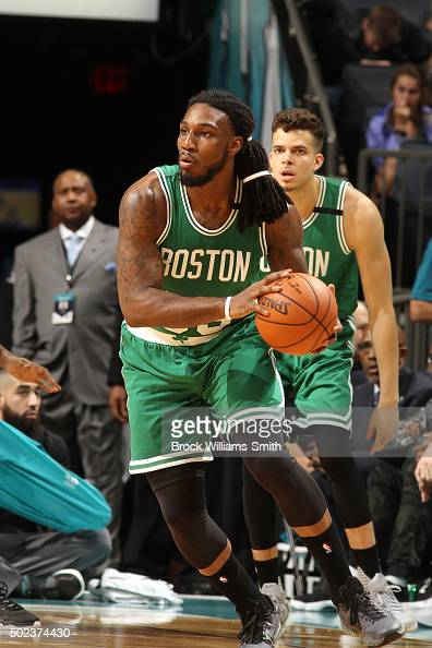 Jae Crowder of the Boston Celtics handles the ball during the game against the Charlotte Hornets on December 23 2015 at Time Warner Cable Arena in...