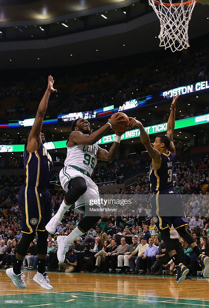 Jae Crowder #99 of the Boston Celtics is fouled by George Hill #3 of the Indiana Pacers with pressure from C.J. Miles #0 during the fourth quarter at TD Garden on April 1, 2015 in Boston, Massachusetts. The Celtics defeat the Pacers 100-87.